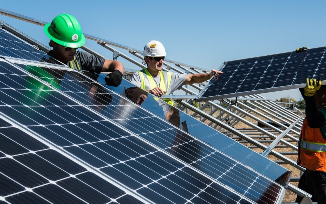 olar panels being installed - renewable energy