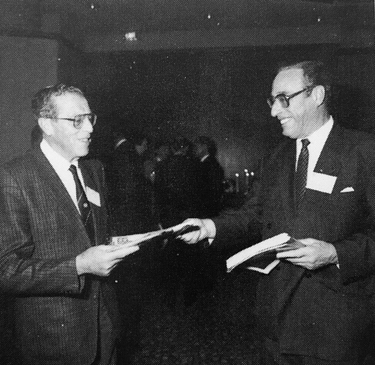 Dr Karl Fritschi, Swiss Ambassador to The Netherlands, receiving a book at the Swiss Chamber of Commerce in the Netherlands event in 1991